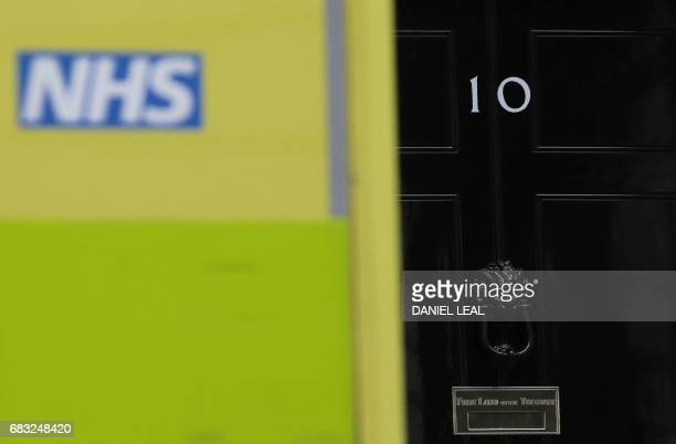 An NHS emergency ambulance is pictured outside the door of 10 Downing Street the official residence of Britain's Prime Minister in central London on...