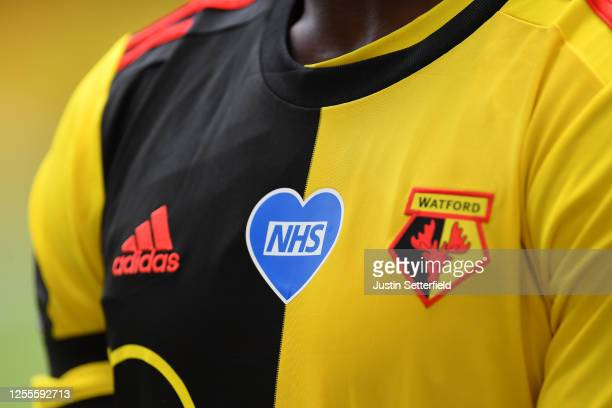 An NHS heart logo is seen on the shirt of Danny Welbeck of Watford during the Premier League match between Watford FC and Newcastle United at...