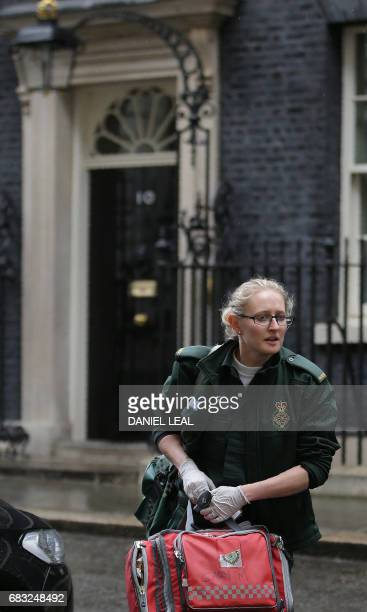 An NHS paramedic carries a medical kit bag after being called to 10 Downing Street the official residence of Britain's Prime Minister in central...