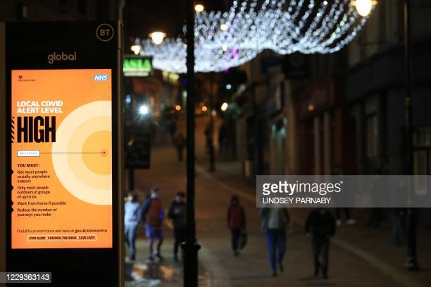 An NHS sign displaying the Local Covid Alert Level as 'high' is seen in Bradford, West Yorkshire, northern England, on October 30, 2020 as the city...