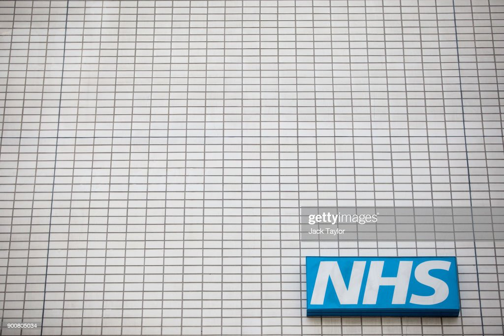 An NHS sign sits on the outside of Guy's and St Thomas' Hospital on January 3, 2018 in London, England. Hospitals in the UK have been advised to postpone all non-urgent operations until the end of January as the NHS struggles to cope with the surge in patients over the winter period.