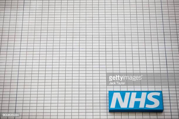 An NHS sign sits on the outside of Guy's and St Thomas' Hospital on January 3 2018 in London England Hospitals in the UK have been advised to...