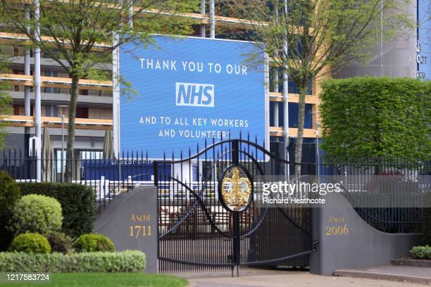 An NHS support sign is seen behind the gates to Ascot Racecourse on April 08, 2020 in Ascot, England. The organiser's of June's Royal Ascot meeting...