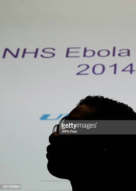 An NHS volunteer is silhouetted against a screen during a National Health Service volunteer induction and Ebola information session at the Ministry...