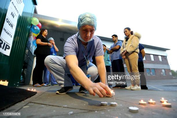 An NHS worker lays down candles in memory of a colleague at Newham University Hospital on April 23 2020 in London United Kingdom Following the...