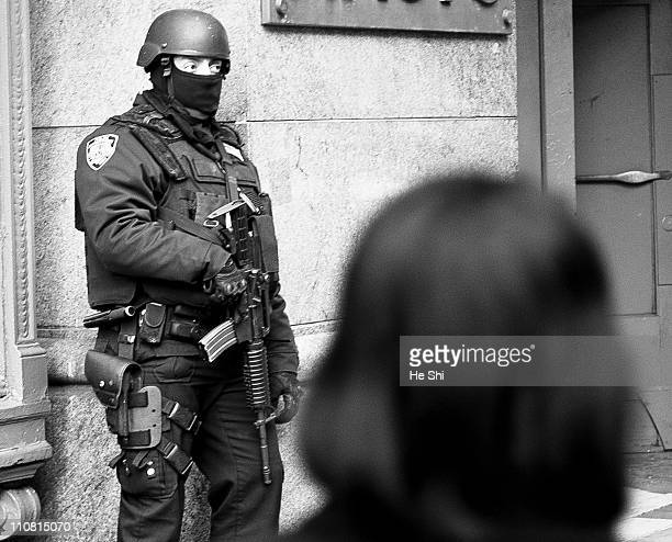 An NYPD ESU officer Footposting on 34th Street Harald Sqaure during a Hercules Deployment. Counter terrorism SWAT New York City NYC.