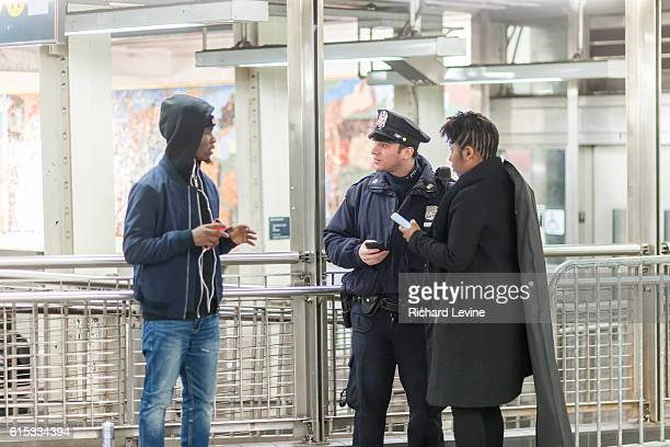 An NYPD officer assists travelers at his post in the New York subway in Times Square on Tuesday March 22 2016 Security in New York has been...