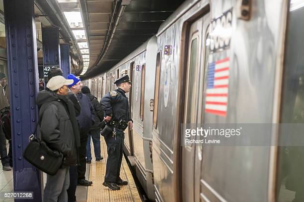 An NYPD officer during an investigation in the Times Square station in New York on Wednesday, March 2, 2016. The NYPD announced an effort to combat a...