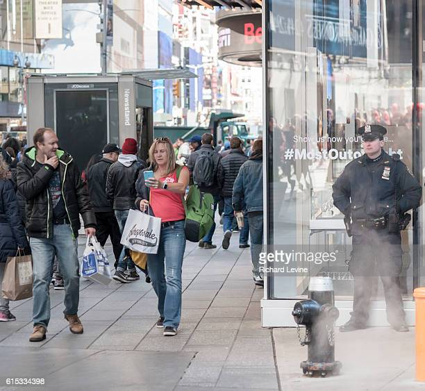 An NYPD officer on his post in New York in Times Square on Tuesday, March 22, 2016. Security in New York has been heightened in the wake of the...