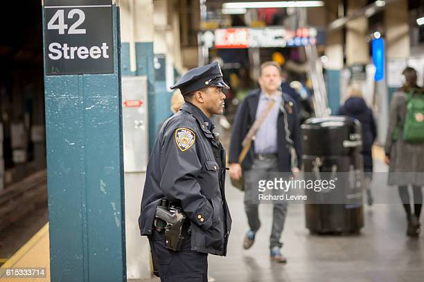 An NYPD officer on his post in the New York subway in Times Square on Tuesday March 22 2016 Security in New York has been heightened in the wake of...