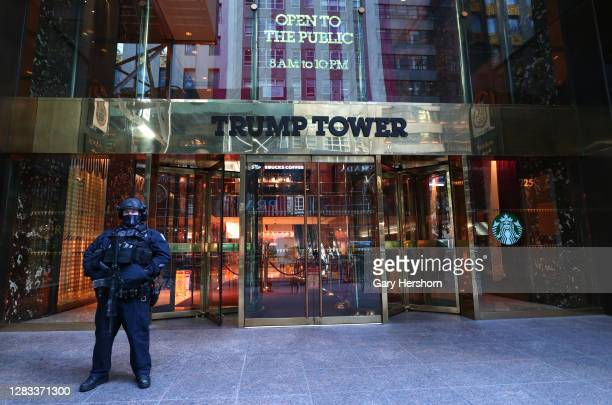 An NYPD police officer stands guard outside the Trump Tower on Fifth Avenue on October 31, 2020 in New York City.