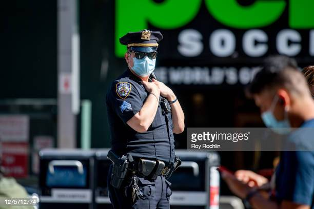 An NYPD police officer wears a mask in Times Square during the fourth phase of the coronavirus reopening in Manhattan on September 22, 2020 in New...
