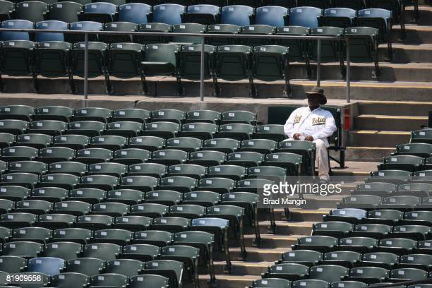An Oakland Athletics fan is surrounded by empty seats during the game between the Seattle Mariners and the Oakland Athletics at the McAfee Coliseum...