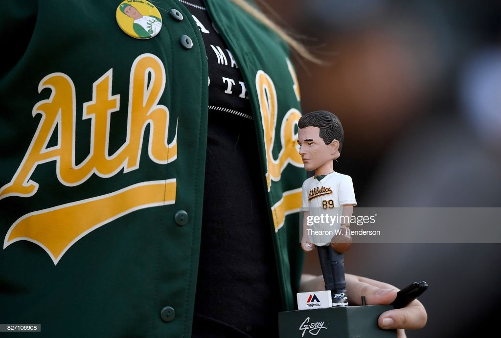reputable site d39cd 7192c An Oakland Athletics fan seaking autographs while holding on ...