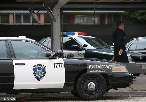An Oakland Police officer walks by patrol cars at the Oakland Police headquarters on December 6 2012 in Oakland California Oakland City officials...