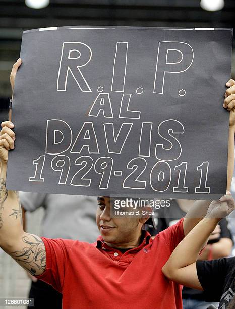 An Oakland Raiders fan holds an Al Davis R.I.P. Sign before the Oakland Raiders played against the Houston Texans on October 9, 2011 at Reliant...
