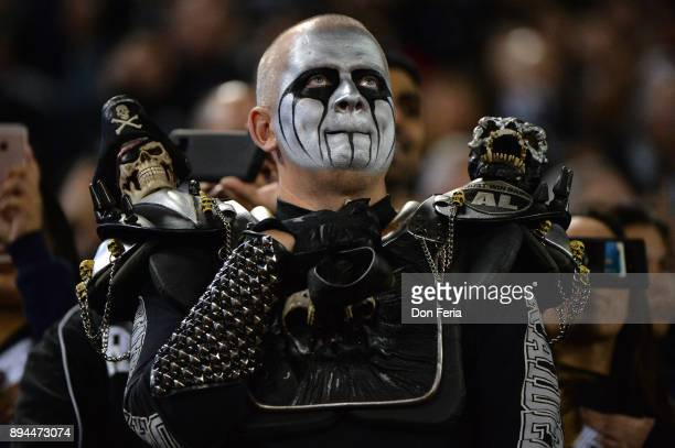 An Oakland Raiders fan stands in the stands during the NFL game against the Dallas Cowboys at OaklandAlameda County Coliseum on December 17 2017 in...