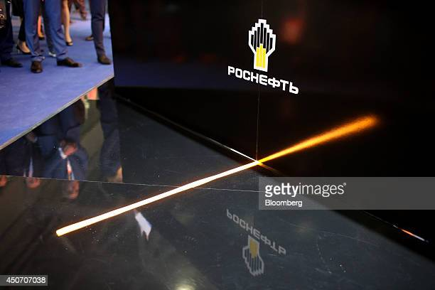 An OAO Rosneft logo sits on a display stand the company's corporate pavilion during the 21st World Petroleum Congress in Moscow Russia on Monday June...
