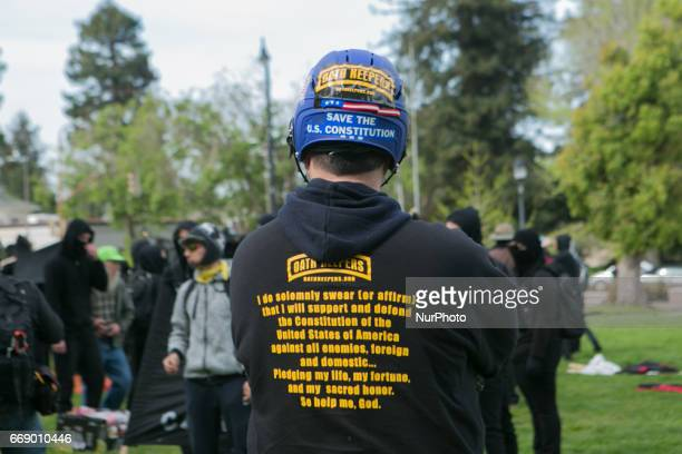 An Oathkeeper stands before a group of antifascists during a free speech rally at Martin Luther King Jr Civic Center Park in Berkeley California...