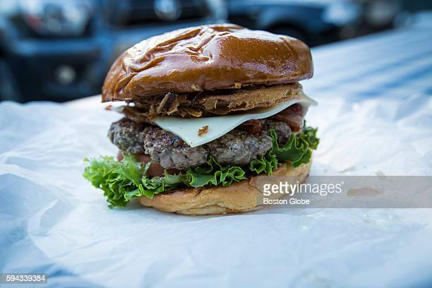 An Obama Burger sits on a table at John's Fish Market in Vineyard Haven Mass on the island of Martha's Vineyard Aug 18 2016 President Barack Obama...