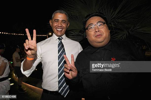 An Obama impersonator poses with a Kim Jong Un impersonator during the YouTube Space LA 'Carnival Of Souls' Halloween Party at YouTube Space LA on...