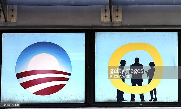 An Obamacare logo is shown on a clinic in Miami Florida on January 10 2017 As Presidentelect Donald Trump's administration prepares to take over...