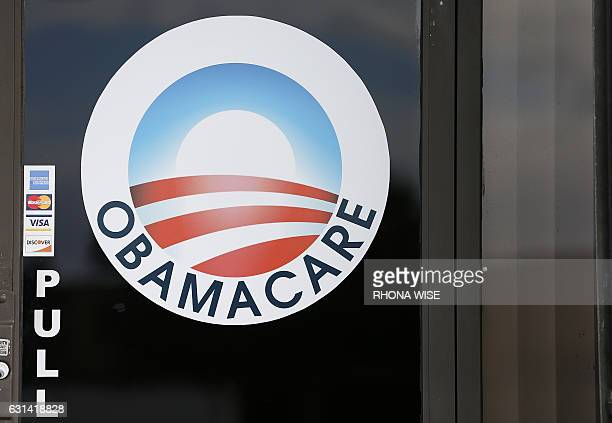 An Obamacare logo is shown on the door of the UniVista Insurance agency in Miami, Florida on January 10, 2017. As President-elect Donald Trump's...