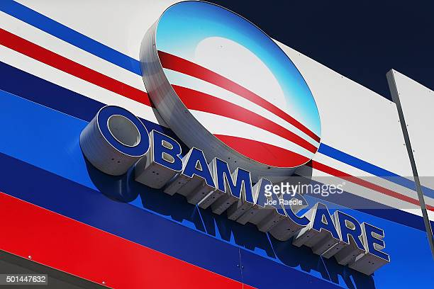 An Obamacare sign is seen on the UniVista Insurance company office on December 15, 2015 in Miami, Florida. Today, is the deadline to sign up for a...