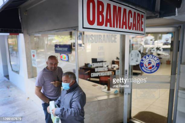 An Obamacare sign is seen outside of the Leading Insurance Agency, which offers plans under the Affordable Care Act on January 28, 2021 in Miami,...