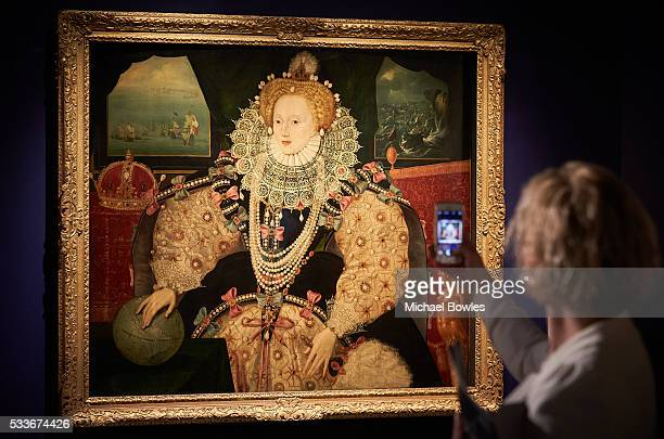 An observer captures an image on her smartphone of The Armada Portrait of Queen Elizabeth I as Art Fund and Royal Museums Greenwich launch public...