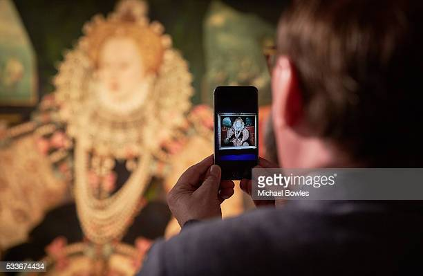 An observer captures an image on his smartphone of The Armada Portrait of Queen Elizabeth I as Art Fund and Royal Museums Greenwich launch public...