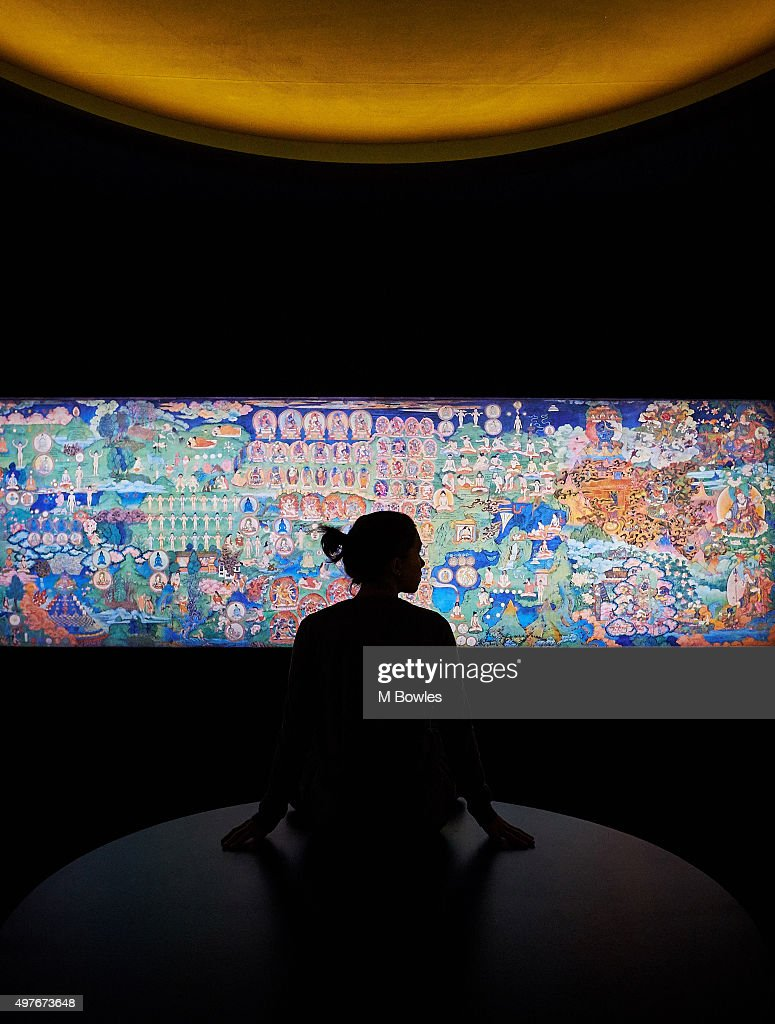 An observer inspects the life-sized digital artworks that recreate the uppermost chamber of the Lukhang Temple, or 'Temple to the Serpent Spirits' built in Lhasa, Tibet, during the late 17th Century, on November 18, 2015 in London, England. The exhibition 'Tibet's Secret Temple' runs at the Wellcome Collection until February 28, 2016.