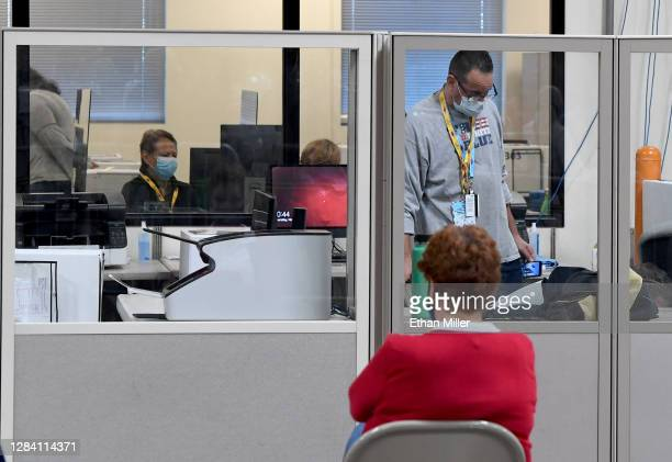 An observer looks on as Clark County election workers count ballots at the Clark County Election Department on November 5, 2020 in North Las Vegas,...