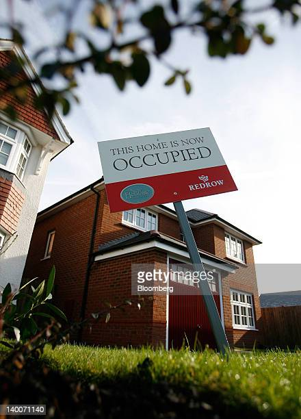 An 'Occupied' sign stands outside a recently completed house at the New Heritage Collection at Hayes Green development a joint venture between Redrow...