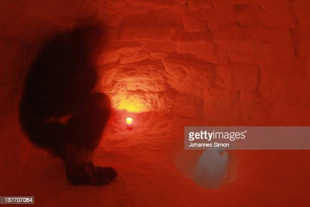 An occupy protester huddles inside an igloo built at the protesters' encampment on January 25 2012 in Davos Switzerland Several hundred Occupy...