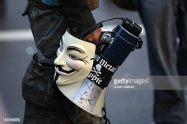 An Occupy Wall Street protestor holds a Guy Fawkes mask and a megaphone during a demonstration on September 17, 2012 in San Francisco, California. An...