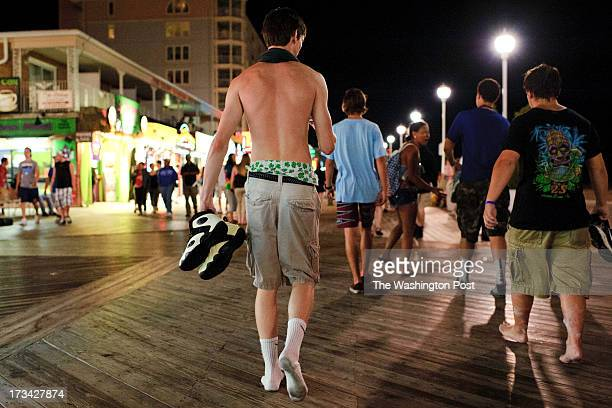 An Ocean City beach patron wears saggy pants while walking with friends on the boardwalk with friends in Ocean City MD on July 11 2013 Ocean City...