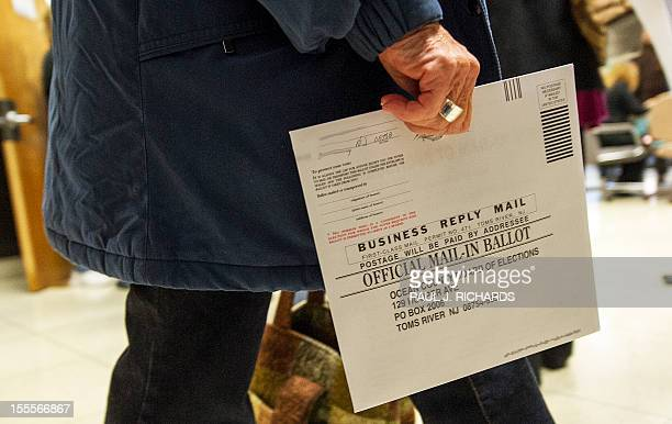 An Ocean County voter in Toms River New Jersey carries her completed ballot in an envelope on November 5 in a special early mail voting arrangement...