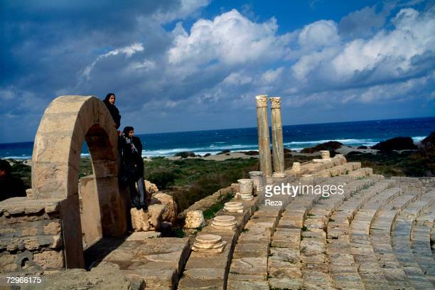 An ocean view is seen from the top of the tiered seating area for the theater ruins of Leptis Magna the largest city of the ancient region of...