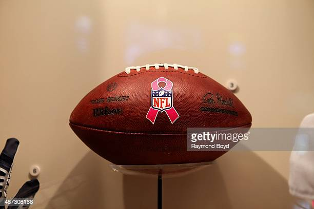 An October 12 2014 game ball stands out amongst encased Green Bay Packers memorabilia inside the Green Bay Packers 'Hall Of Fame' inside the Lambeau...