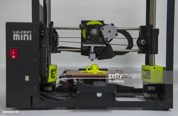 An octopus figurine created with a LulzBot 3D Mini printer sits on the printer at the Aleph Objects Inc production facility in Loveland Colorado US...