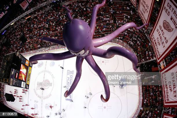 An octopus hangs above the ice as Stephane Robidas of the Dallas Stars hugs goaltender Marty Turco after defeating the Detroit Red Wings in game five...