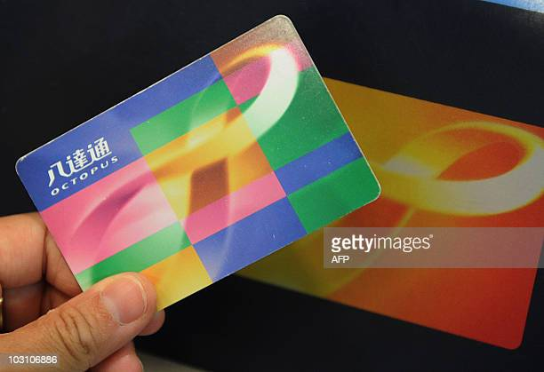 Mtr station hong kong stock photos and pictures getty images an octopus stored value card is displayed above a card scanner at a mass reheart Choice Image