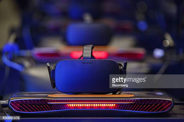 An Oculus Rift virtual reality headset stands during the Intel Corp press event at the 2017 Consumer Electronics Show in Las Vegas Nevada US on...