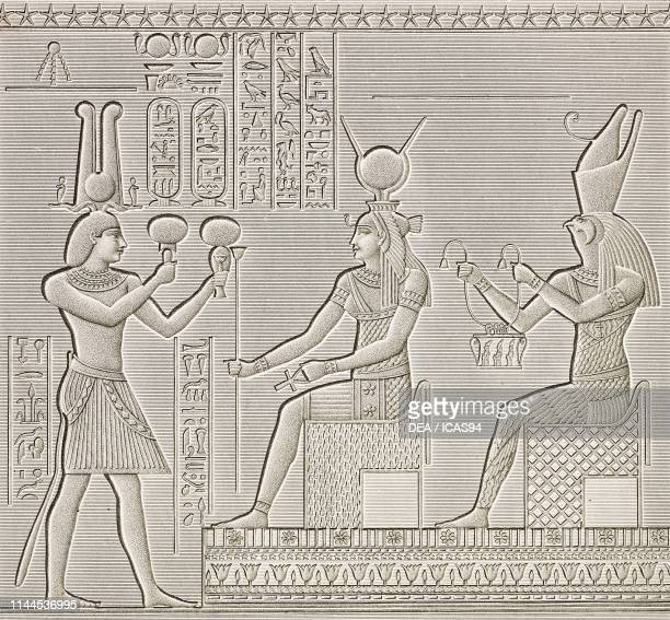 An offering bearer before goddess Isis painted basrelief Hathor Temple portico Dendera Temple complex Egypt engraving by Pomel after a drawing by...
