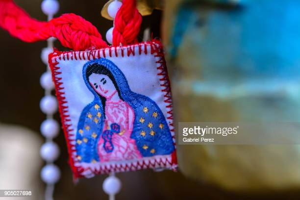 an offering to our lady of guadalupe - virgen de guadalupe fotografías e imágenes de stock