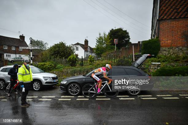 An offical wearing personal protective equitment looks on as a competitor leaves the start line in the 44th Wigmore CC Hollingbourne Hill Climb, on...