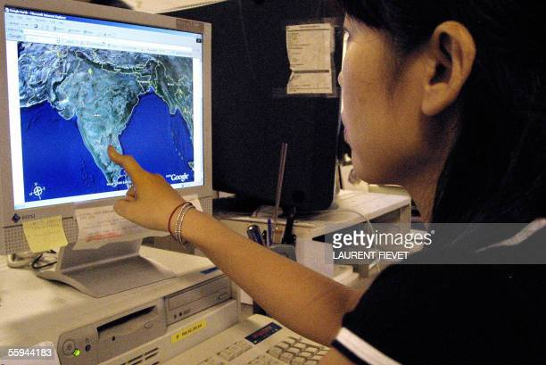 STORY 'INDIAGOOGLESATELLITEMILITARY' An office lady checks out the Indian map on Google's satellite image service on a web site in Hong Kong 18...