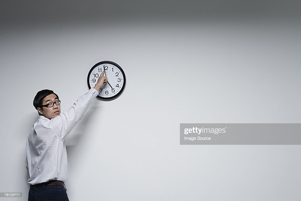An office moving a clocks hands : Stock Photo