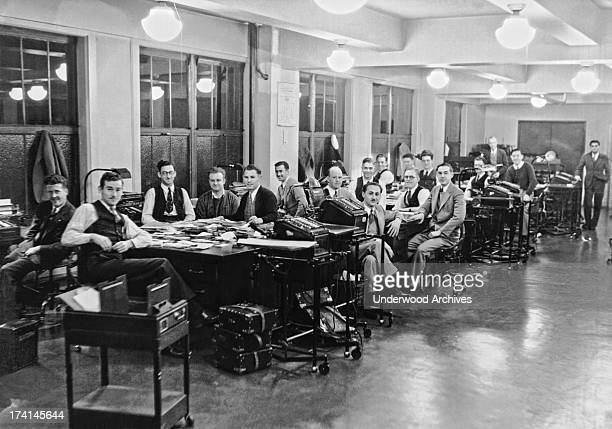 An office scene with many men and tabulating machines United States 1925